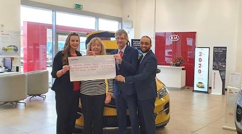 Opus Motor Group has raised almost £20,000 for Teenage Cancer Trust